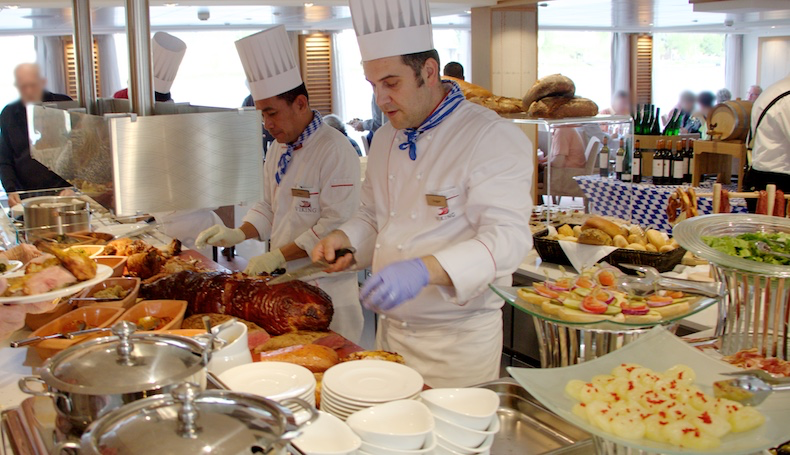 Chefs fill plates as we walk through the buffet line