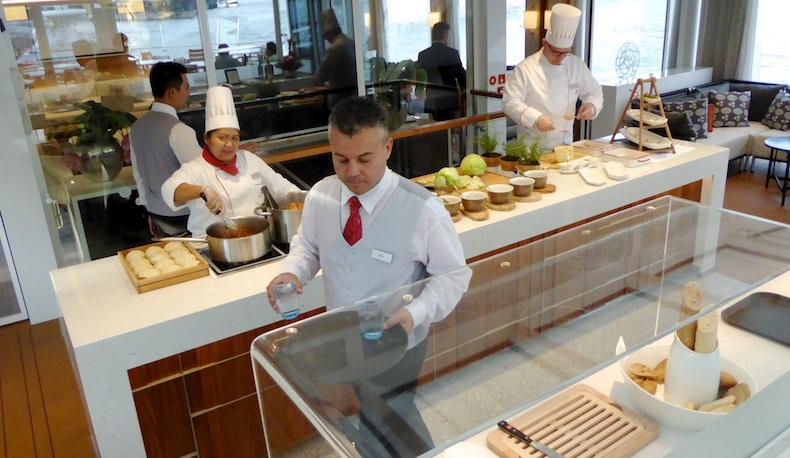 Chefs prepare dinner in Aquavit Terrace