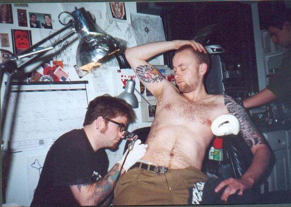 Tattooing Much in 2002. Billy in the background.