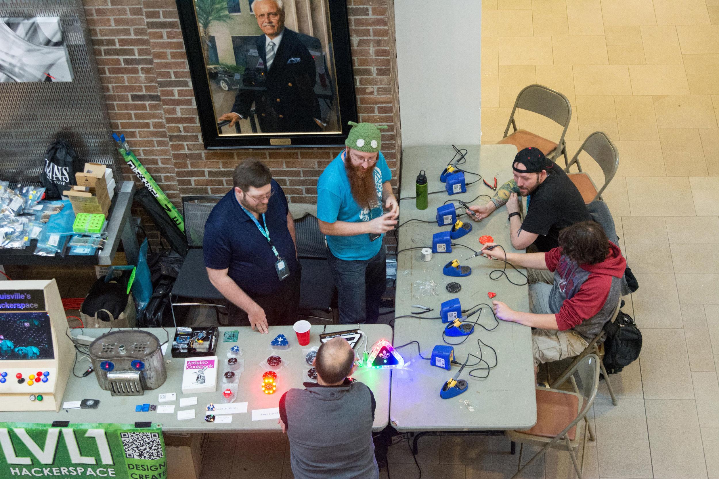Blinky Blink teaching soldering at BSidesCHS