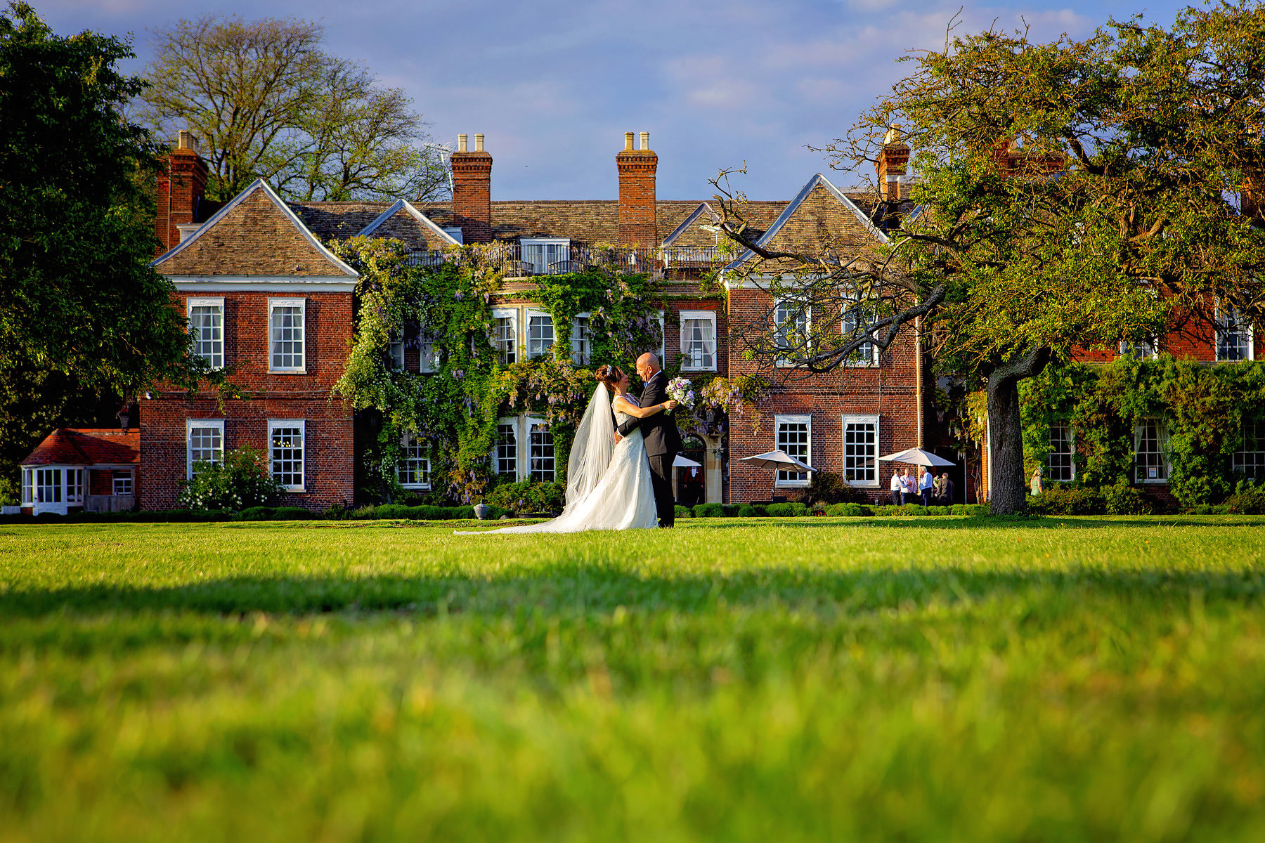 The rear of Anstey Hall bathed in early evening sunlight - perfect for wedding photos.