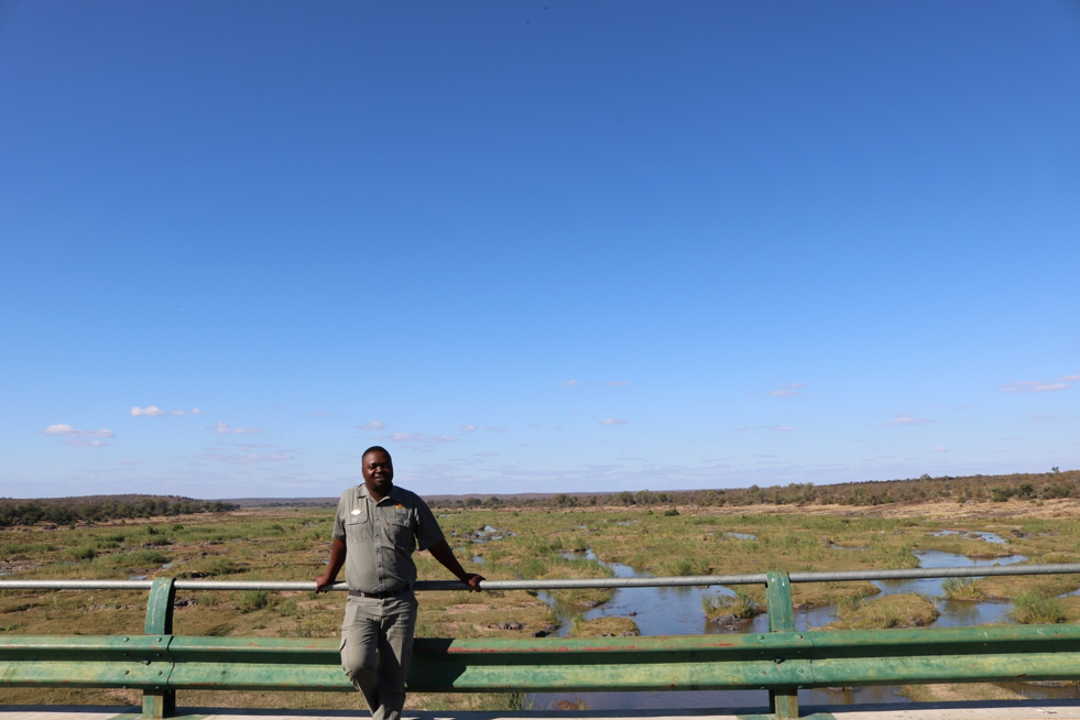 Thomas, our game driver and guide, standing on the bridge above the Oliphants river within Kruger National Park.