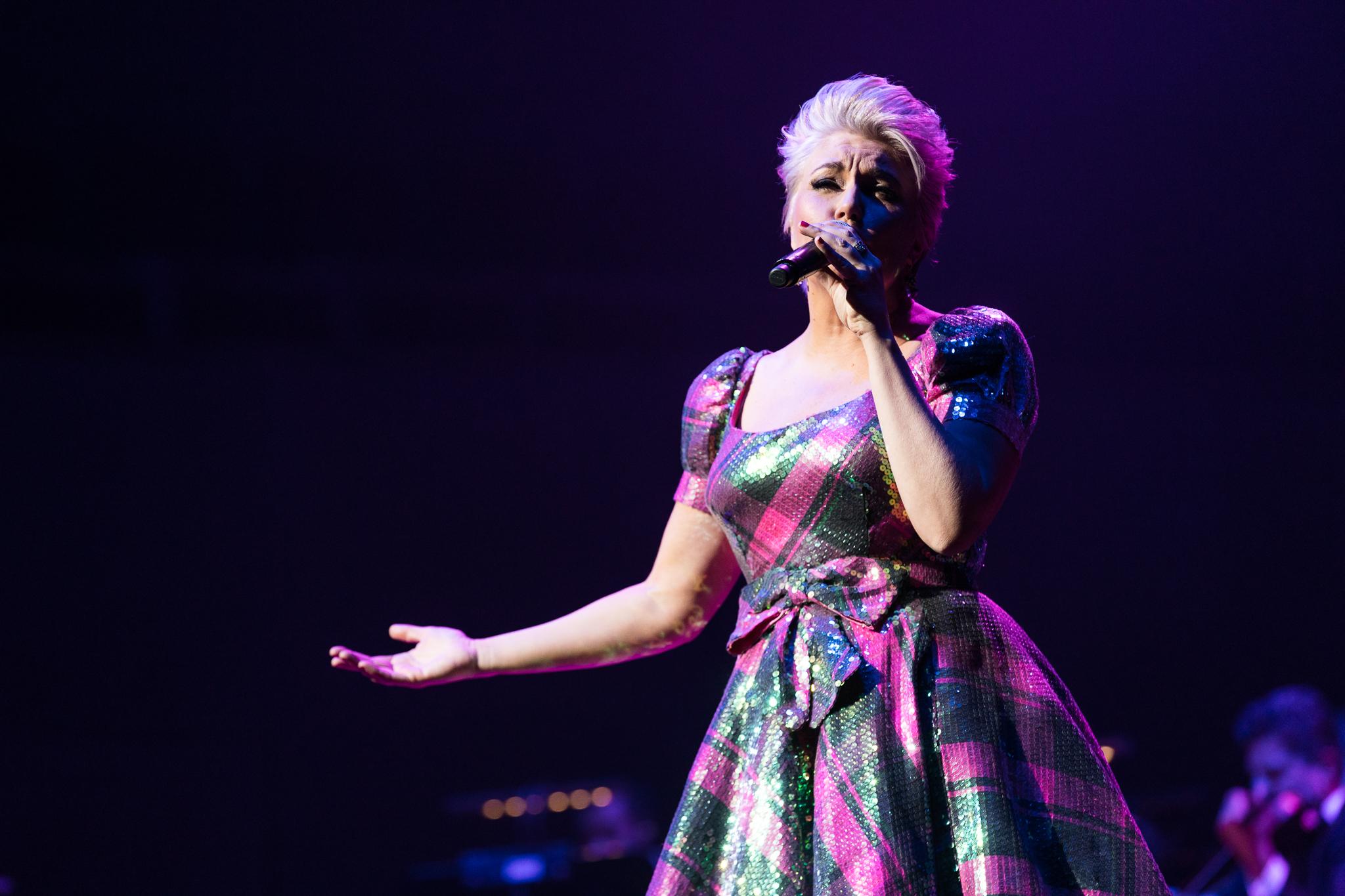 Melinda Schneider in sparkling dress singing on stage