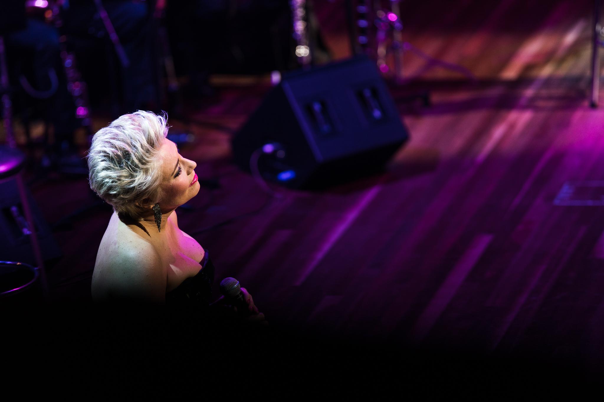On stage image behind Melinda Schneider as she singing