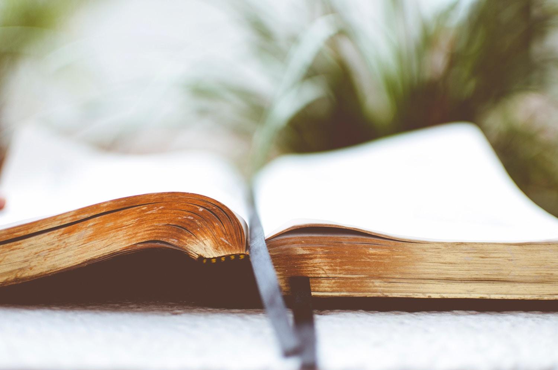 An open, KJV Bible on a table.