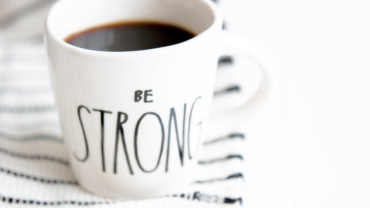 Coffee cup with the words Be Strong