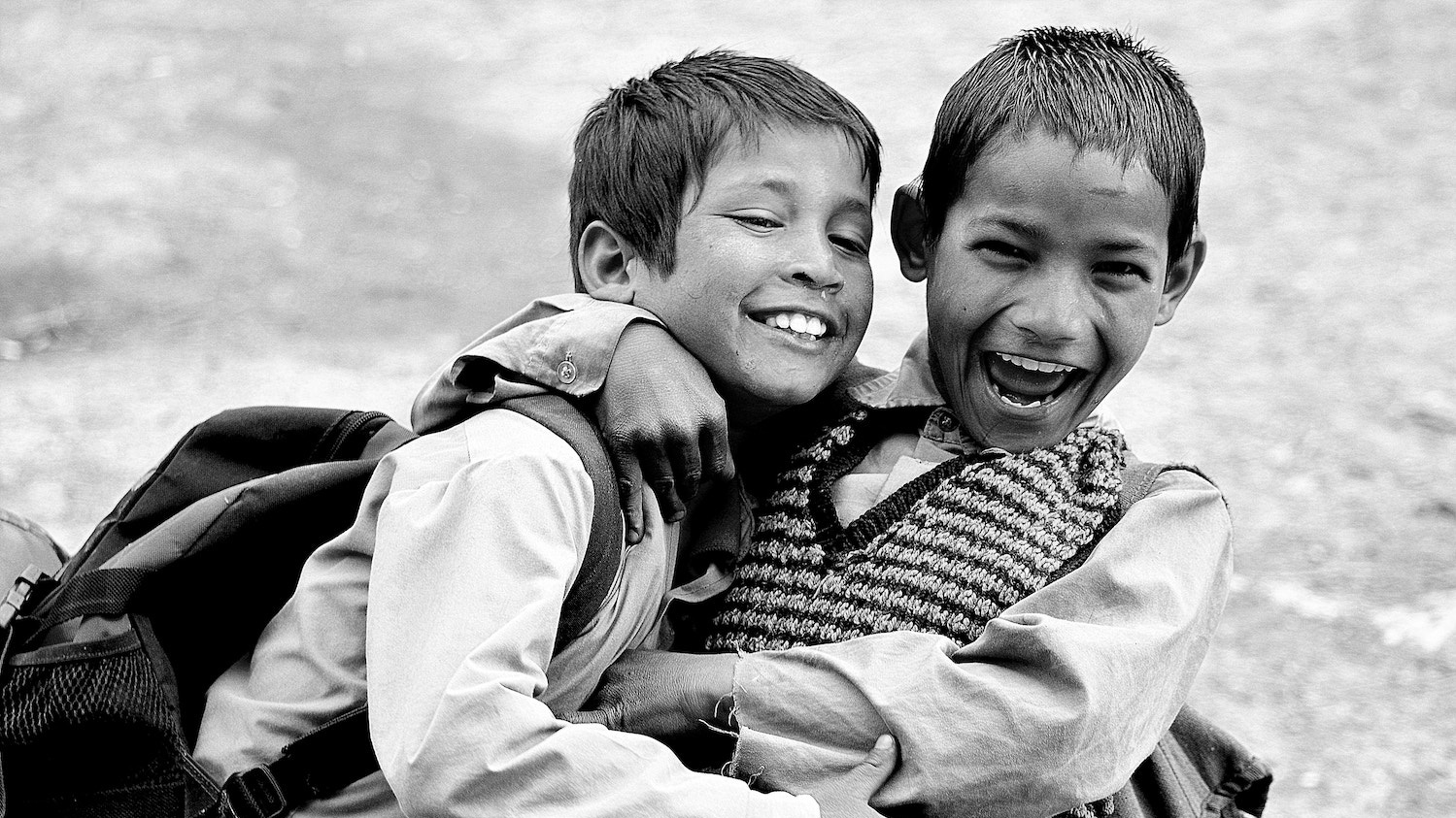 Two young friends laughing together