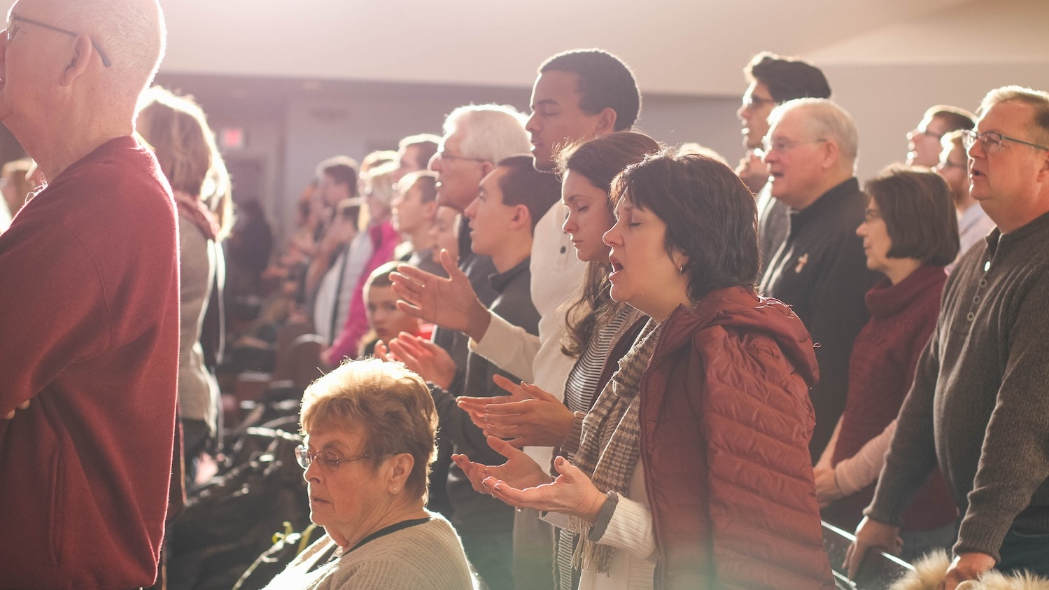 People worshipping and singing in a church