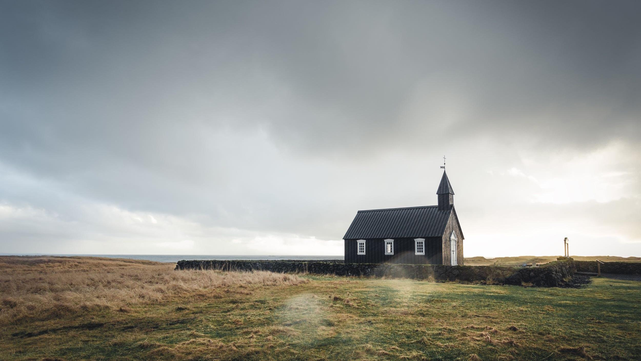 A small church in a stark landscape