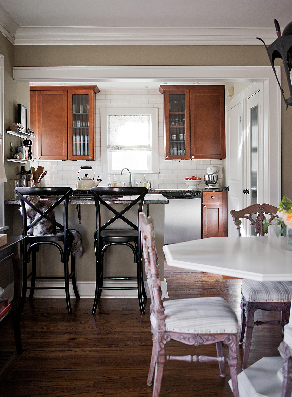 Westwood Hills Bungalow | Amanda Steiner Design | Warm Kitchen with Bar Stools and Dining Area