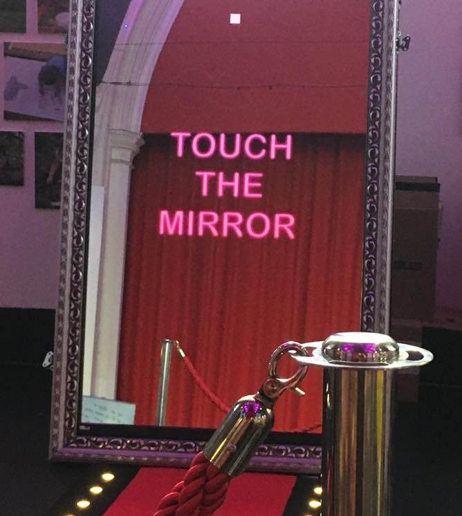 Magic Mirror photo booth - Our Magic Mirror Photo Booth complete with red carpet and props is great to capture the memories of your evening. Guests interact with the mirror and are able to print and keep the pictures taken.