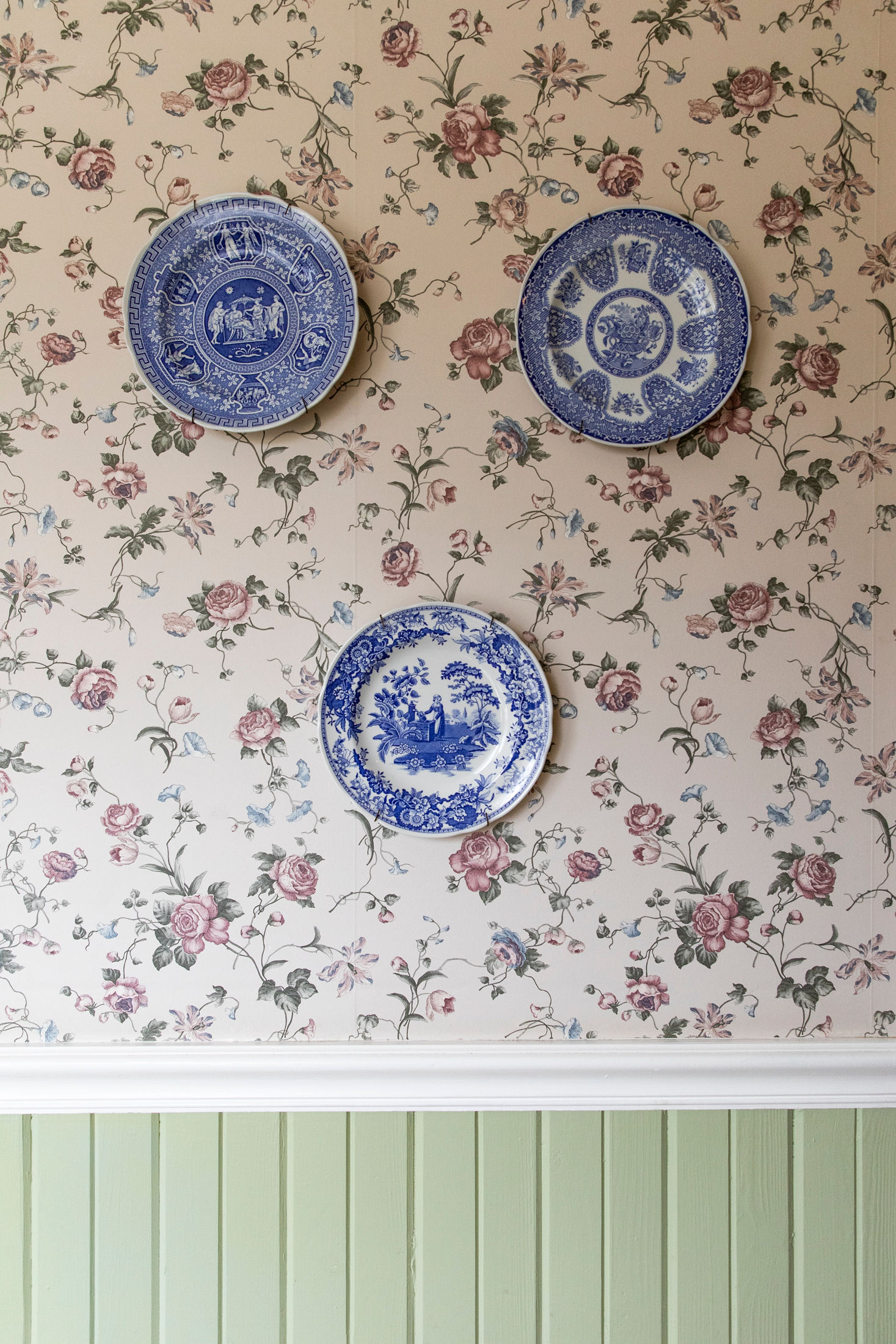 A trio of vintage plates hang on the wall at the Headlands Inn, a Bed & Breakfast in Mendocino, CA