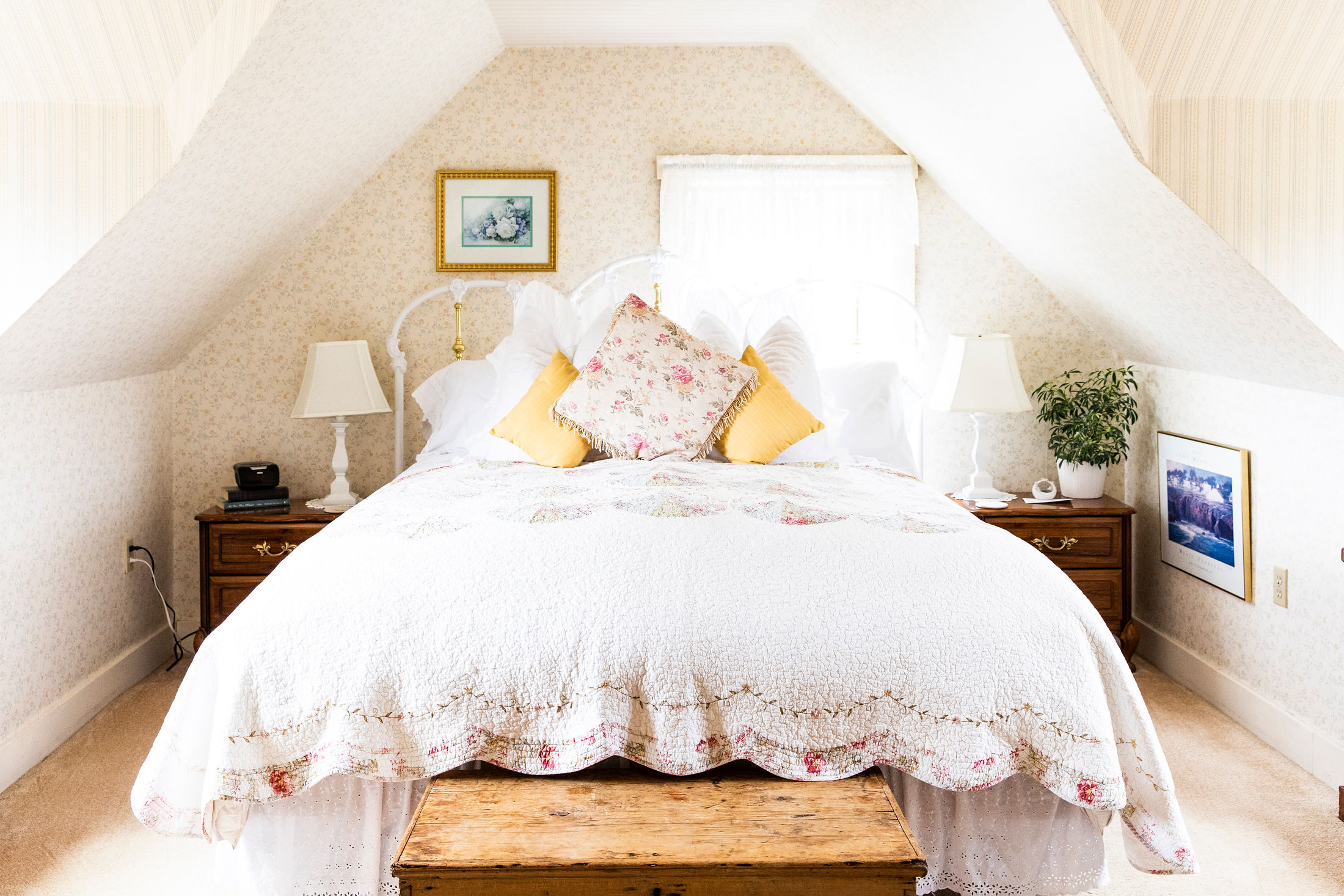 comfortable queen bed in the George Switzer Room at The Headlands Inn in Mendocino, California