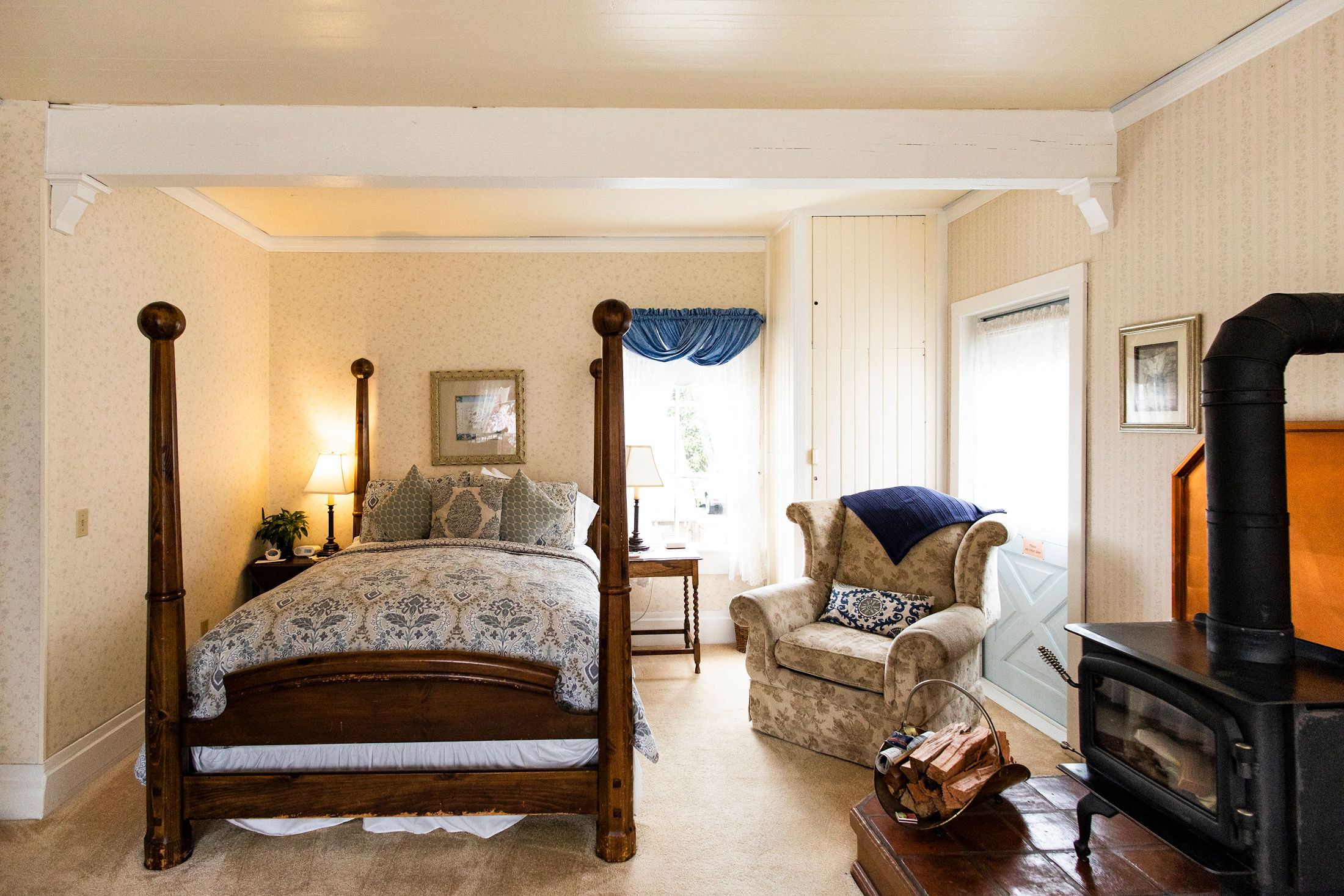 warm and cozy with antique furnishings in the WJ Wilson Room at The Headlands Inn in Mendocino, California