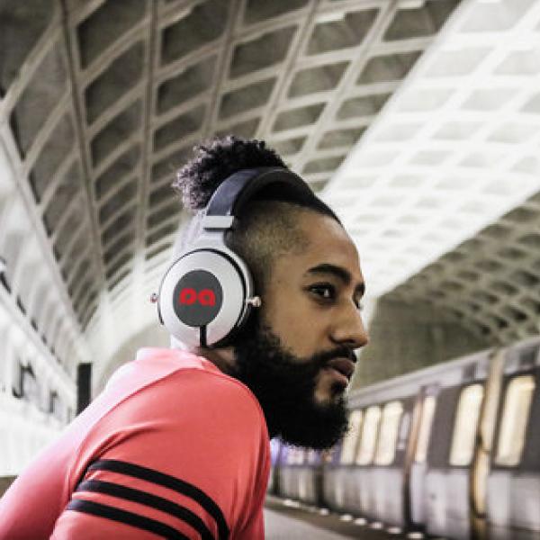 Guy Wearing On Ear Headphones