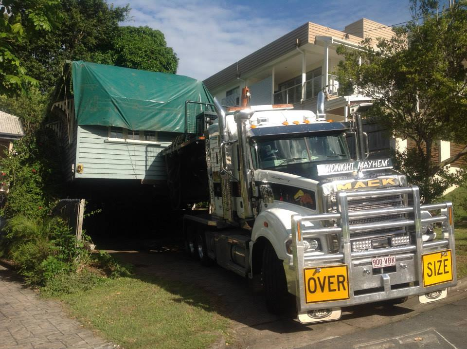 """On The Move. Bringing a new meaning to """"moving house"""".  The orginal house being transported to new location."""
