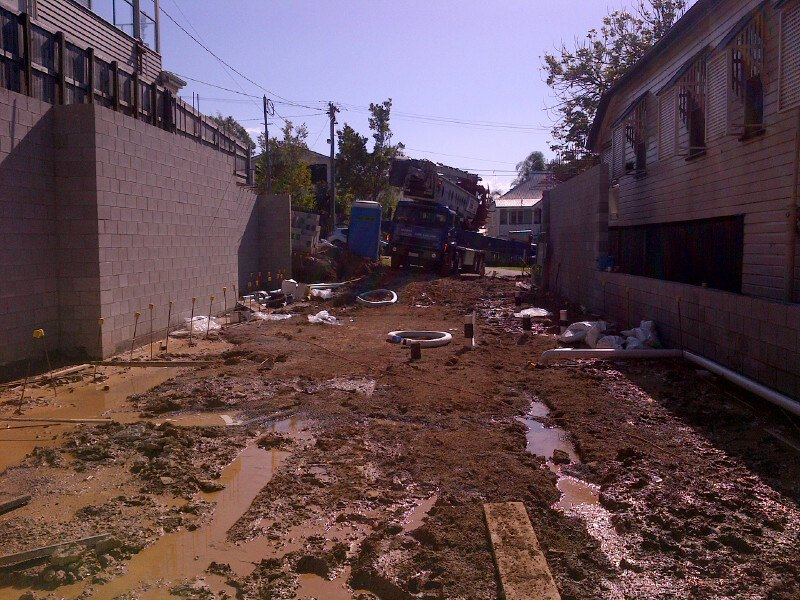 Construction was hindered by drainage issues and wet weather.