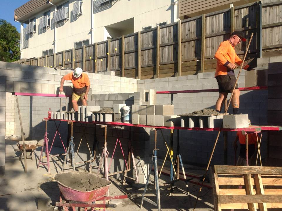 Boys hard at work on the ground floor brick work.