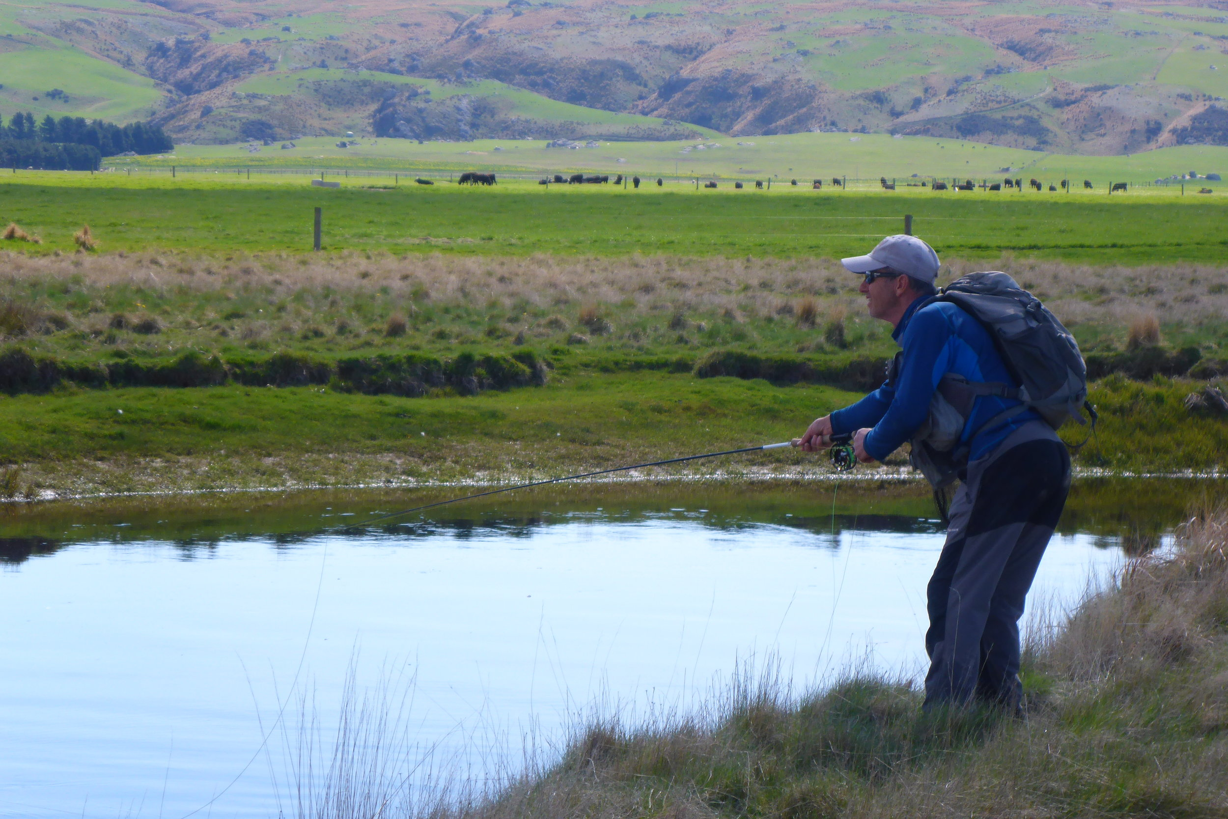 Robbie casting to a riser on the far bank