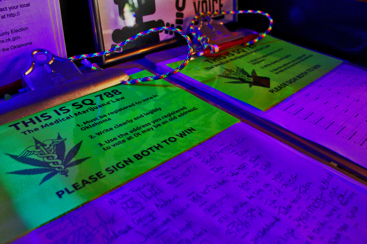 A petition to legalize medical marijuana sits under black lights at The Gypsy Coffee House in Tulsa's Brady District. DYLAN GOFORTH / The Frontier