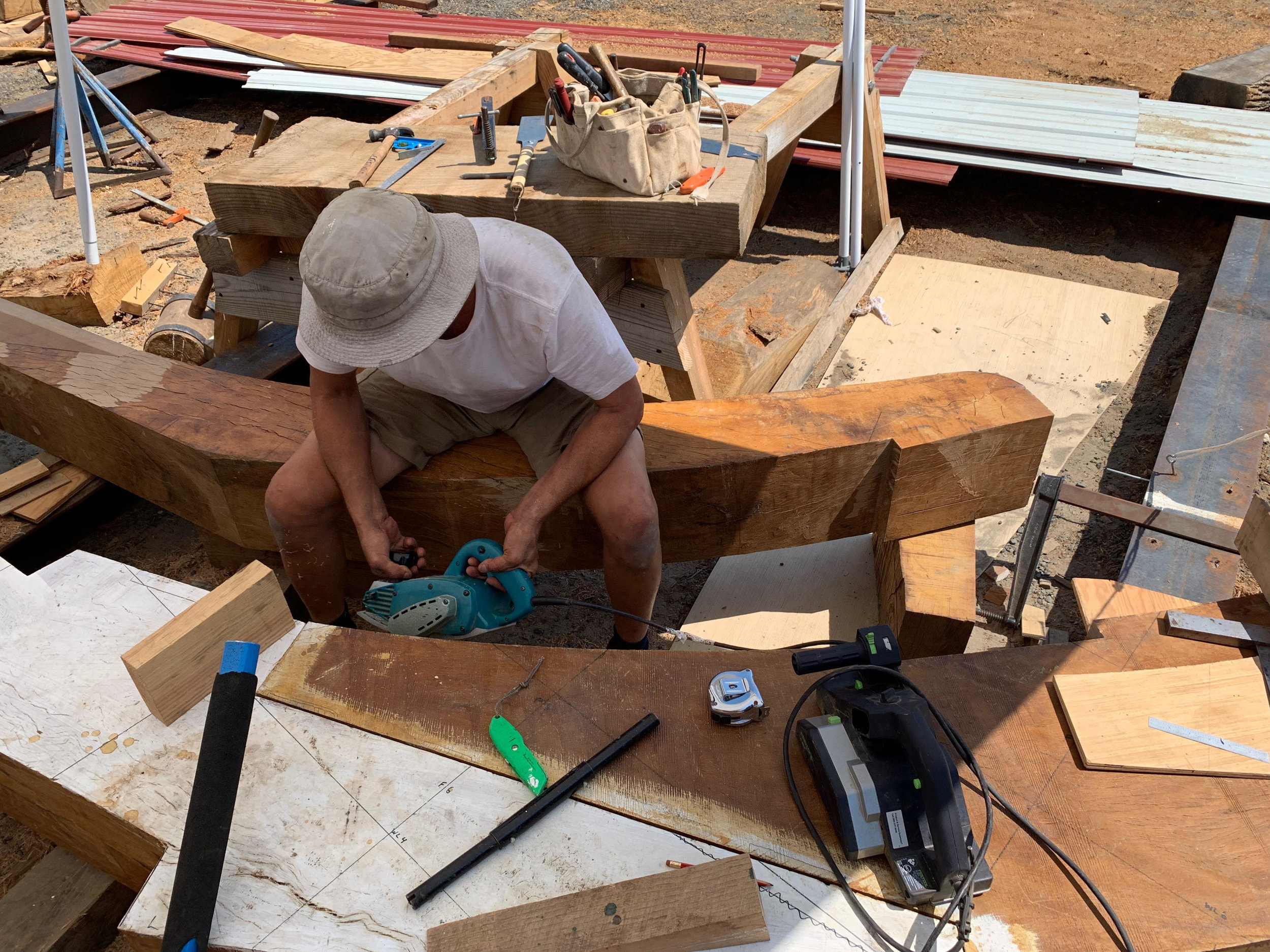 Shipwright Jeff Reid works on fitting our southern live oak apron and stempost using a power compass plane