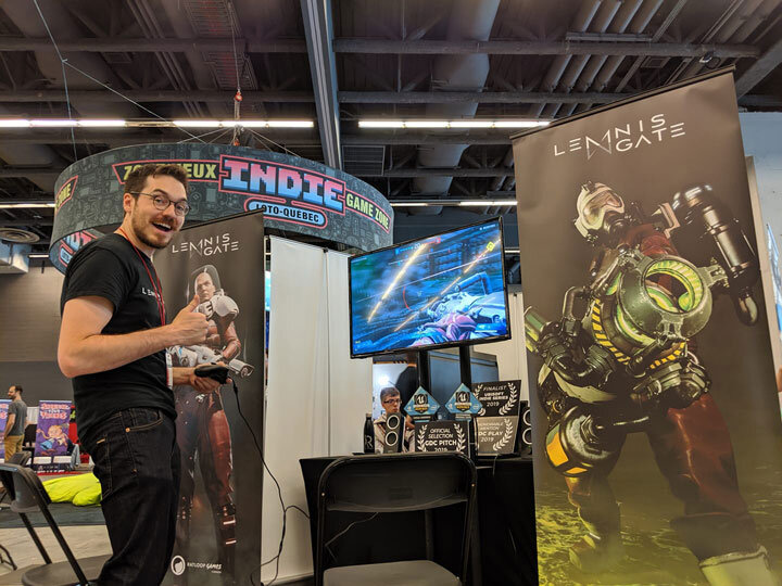 Developer poses in front of Lemnis Gate Booth at Montreal Comic Con 2019.