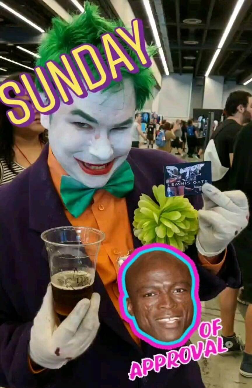 Cosplayer Joker poses holding a beer and a Lemnis Gate card at Comic Con 2019.