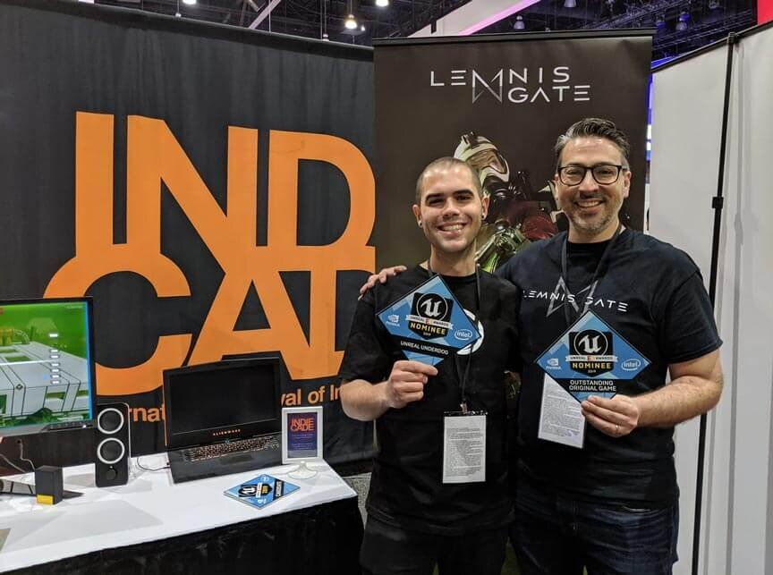 Ratloop Developers pose holding Unreal Awards Nomination plaques.