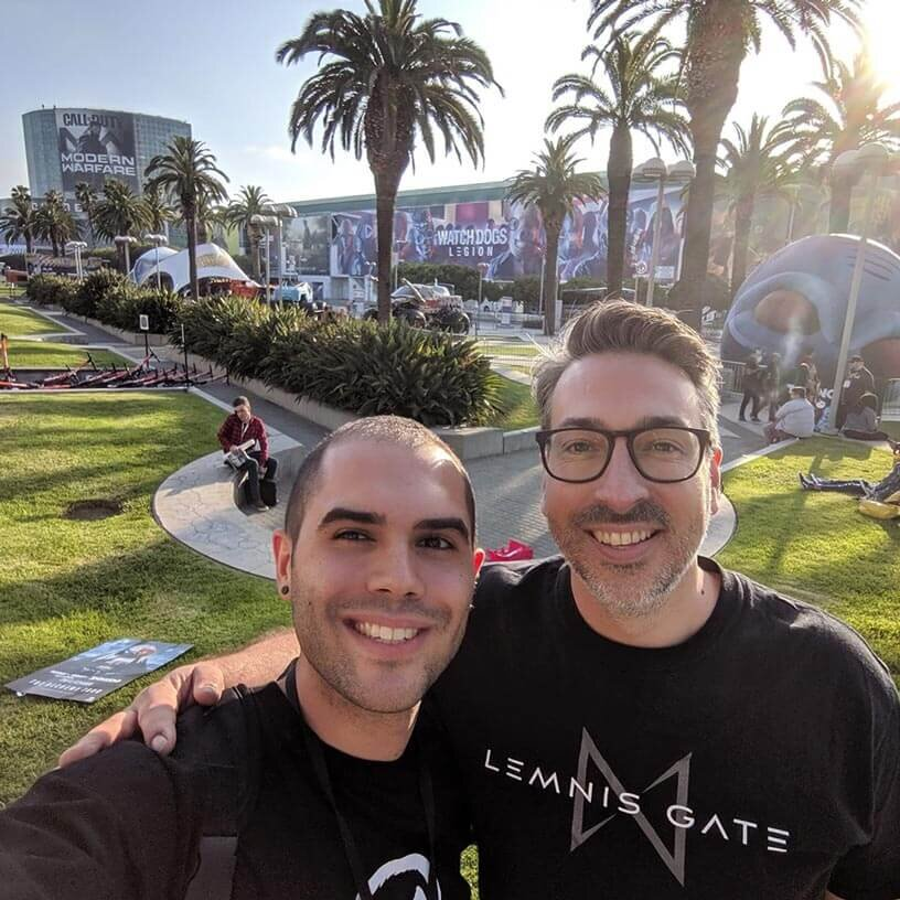 Lemnis Gate Indie developers smiling outside Los Angeles Convention Center.