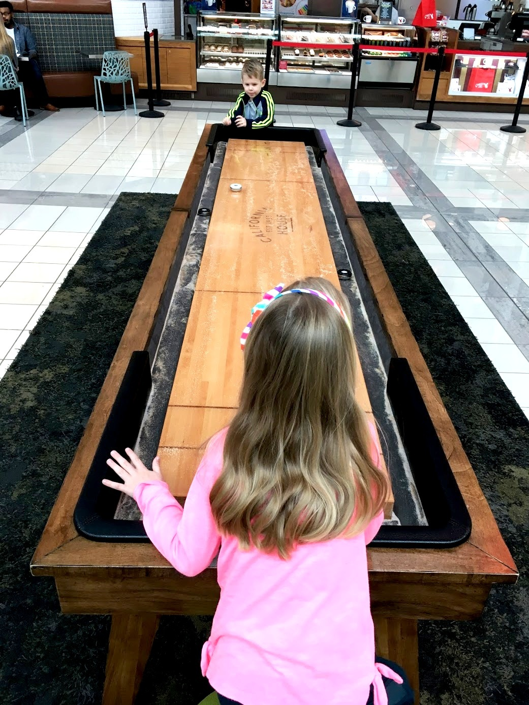 Playing shuffleboard at Stonebriar Centre Frisco
