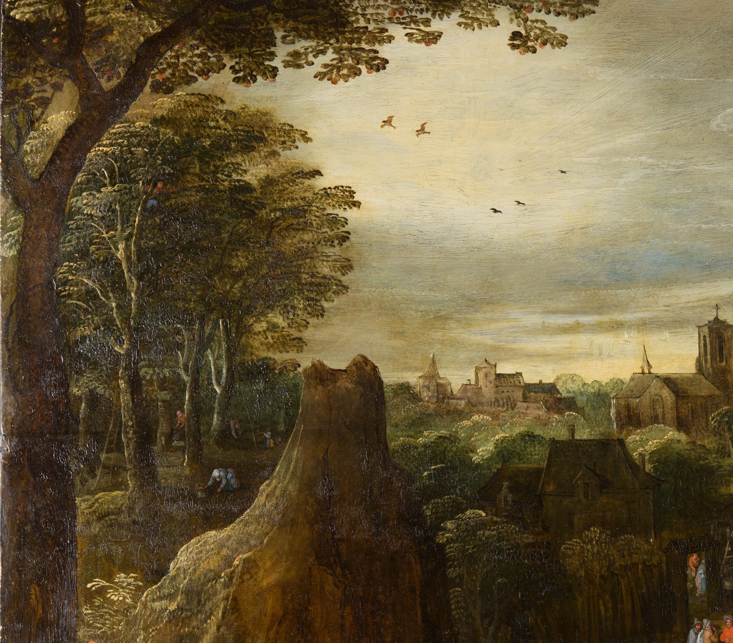 After treatment: the dovecote that was just discernible before treatment proved to be later overpaint, and on removal revealed a rocky outcrop. The tree rising out above the horizon was also a later addition which on removal has revealed a group of buildings, and behind it the river with sailing boats. Note the apple pickers in the woods, and the man in the tree.