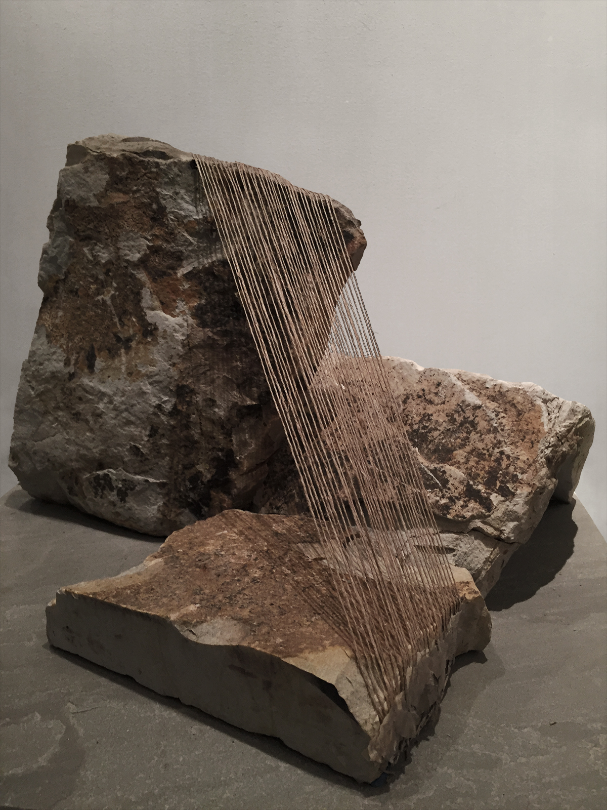 FRAGMENTED   Stone, thread  12 x 17.5 x 17.5 Inches