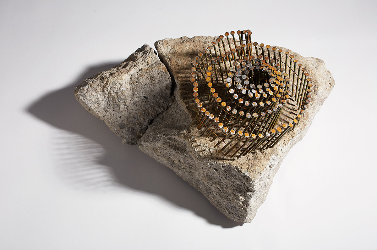 NAIL PIECE   Stone, nails  7 x 16 x 11 Inches