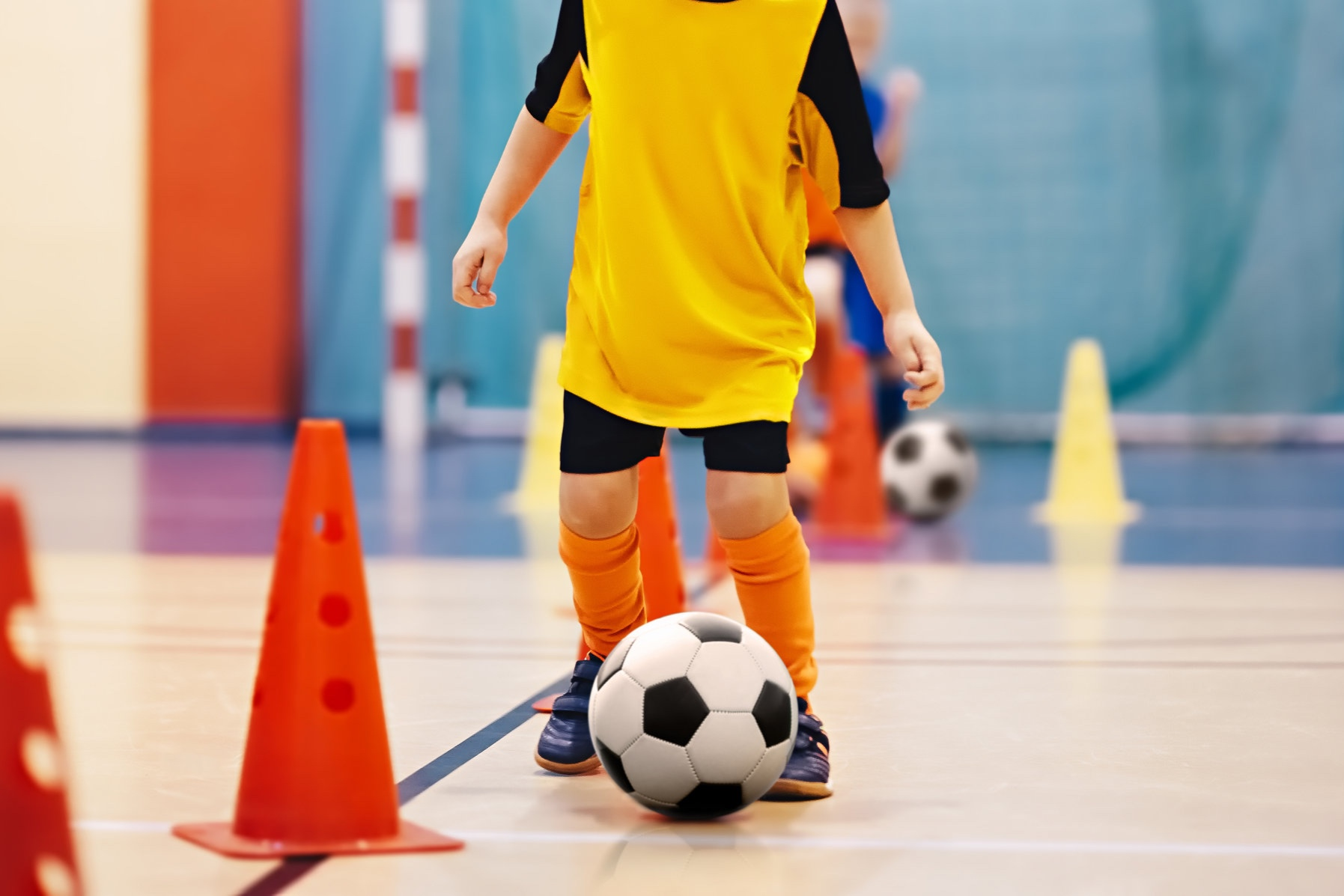 4 - 5 Years - Children in this class will learn how to dribble and kick the soccer ball with both feet and will participate in a variety of fun games