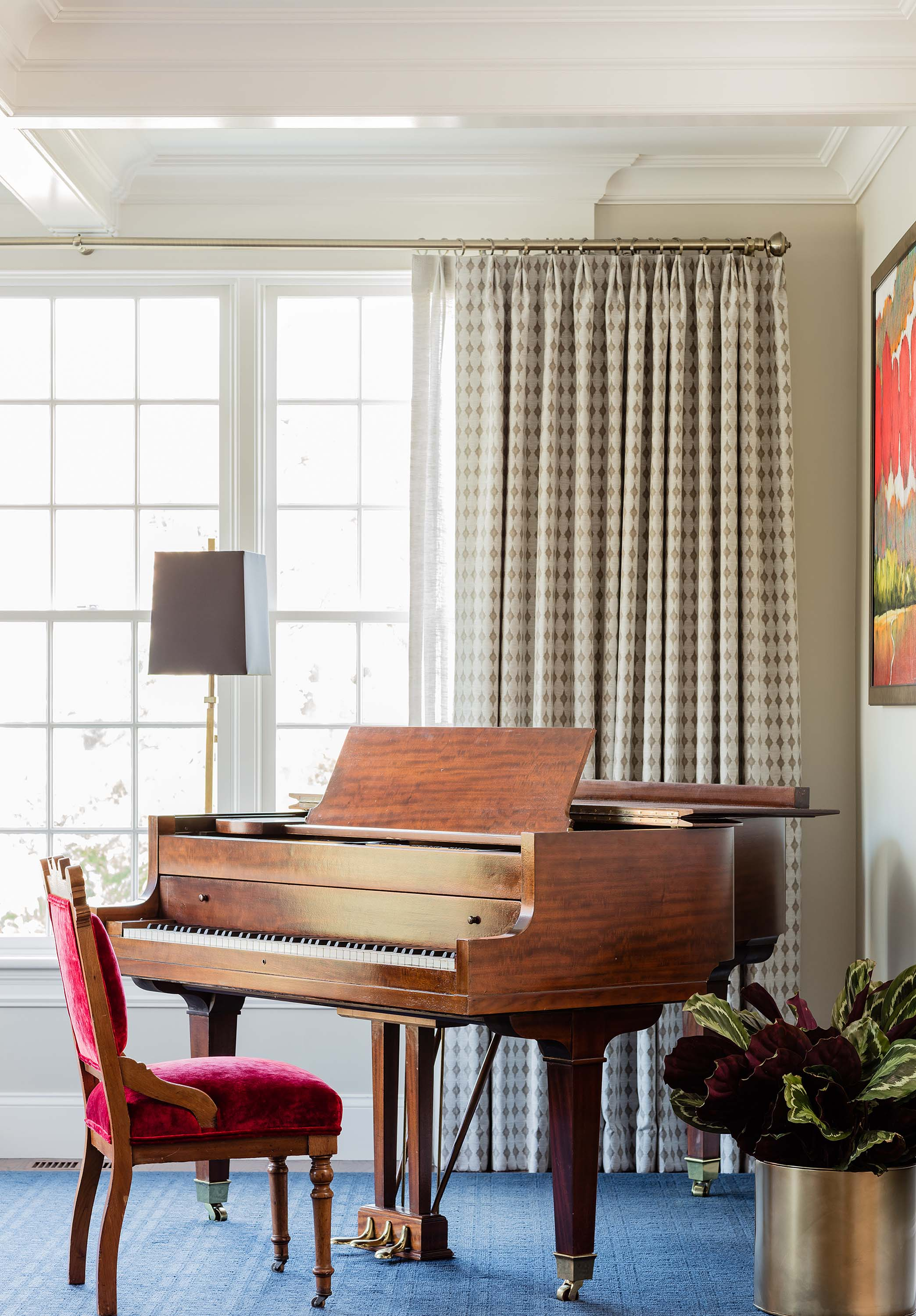House interior with grand piano and velvet covered chair, rogers and goffigon fabric, arabesque, arabesque fabric, blue rug