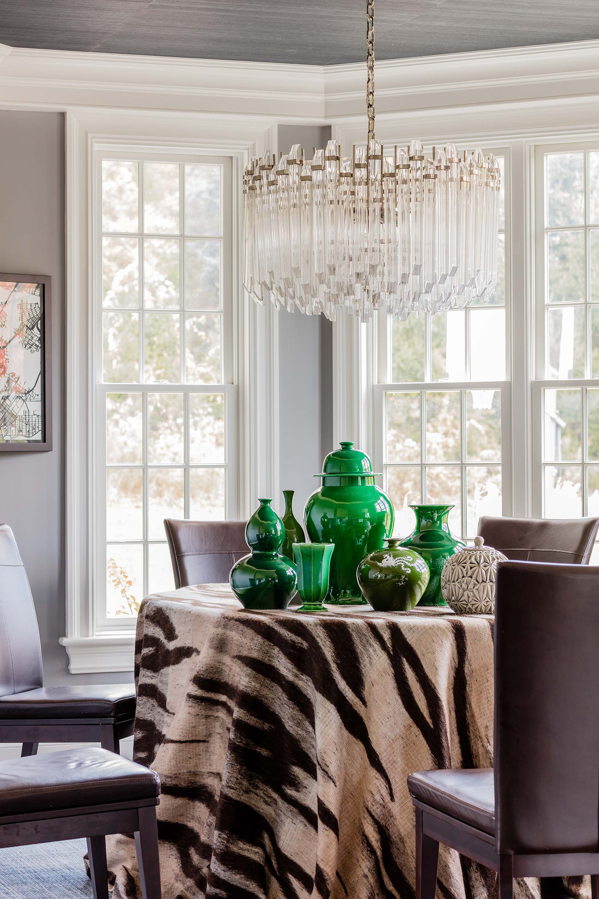 Round table with ceramic vases, chairs, and a chandelier, green vase, green ginger jar, mohair, mohair table skirt, table skirt, visual comfort, adele chandelier, adele, ceiling wallpaper, blue silk wallpaper