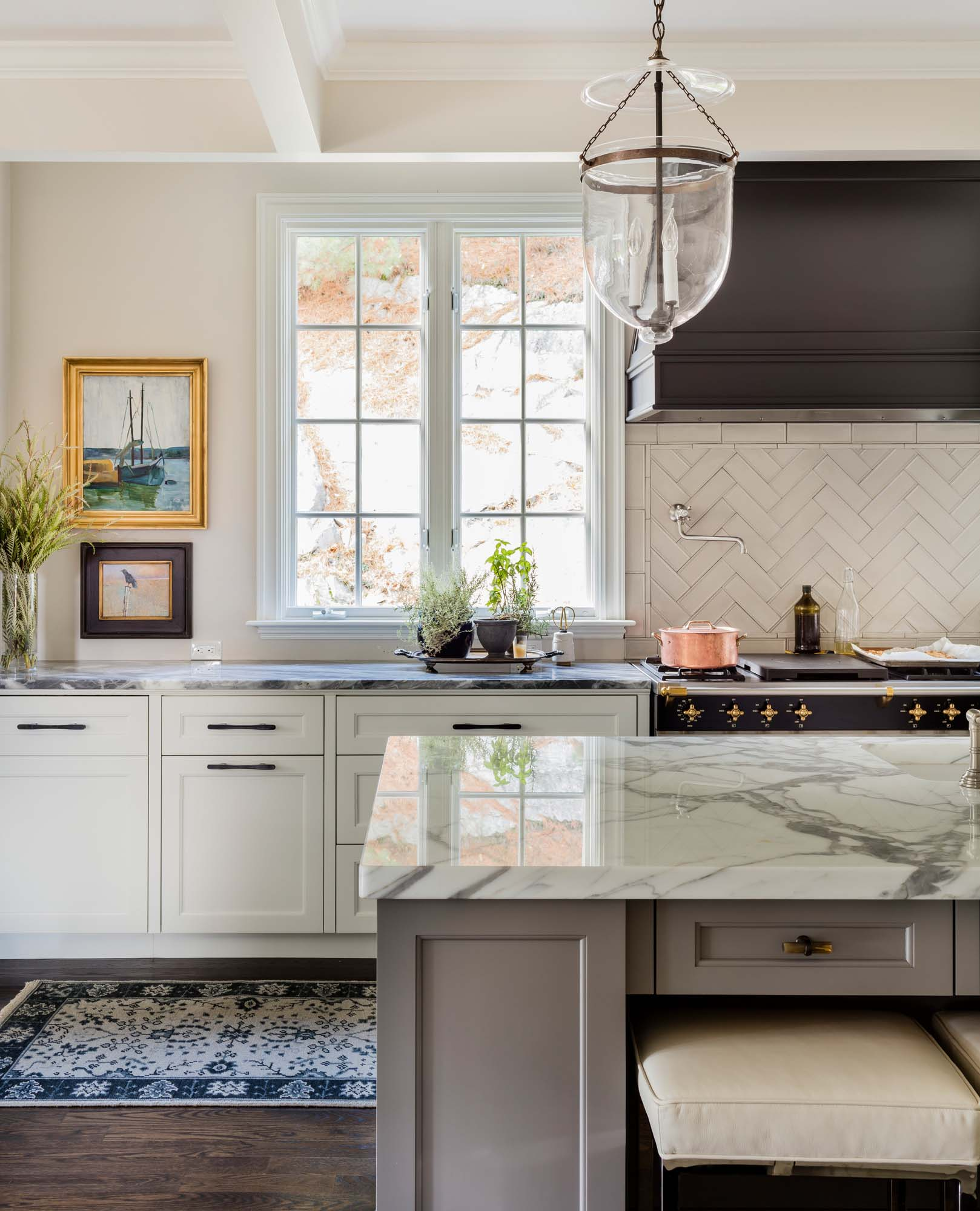 Kitchen with center island and  not ceramic  countertop, hardwood floor and drawers, Calcutta marble, Lacanche Sully range, Lacanche, perrin, rohl, copper pot, custom white cabinet, sherwin williams tricorn black, benjamin moore white dove, horn cabinet pull, horn handle