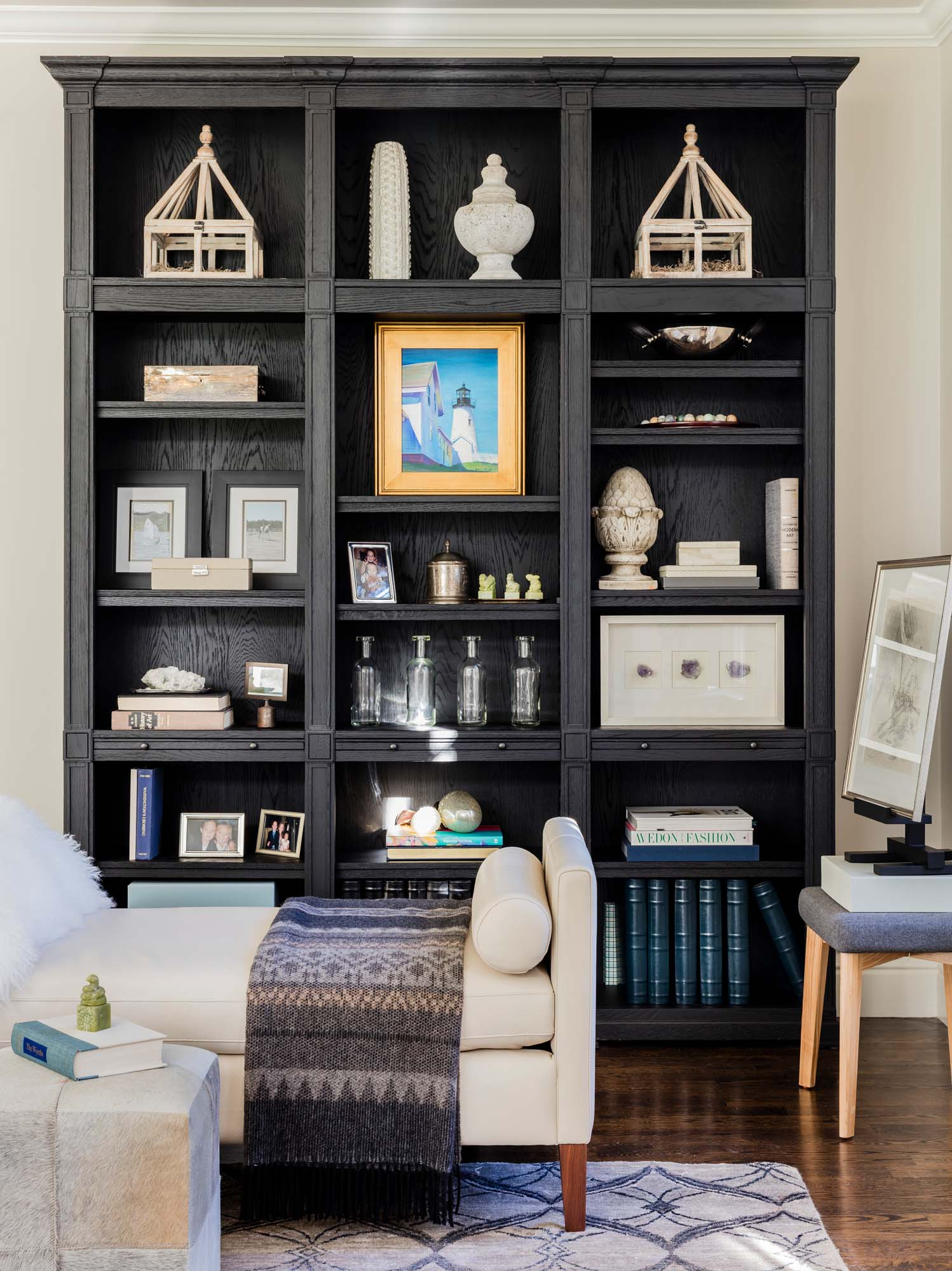 House interior with wooden shelves, hardwood floor, and chair, day bed, daybed, white leather, rh, restoration hardware black oak, black oak, benjamin moore, winds breath