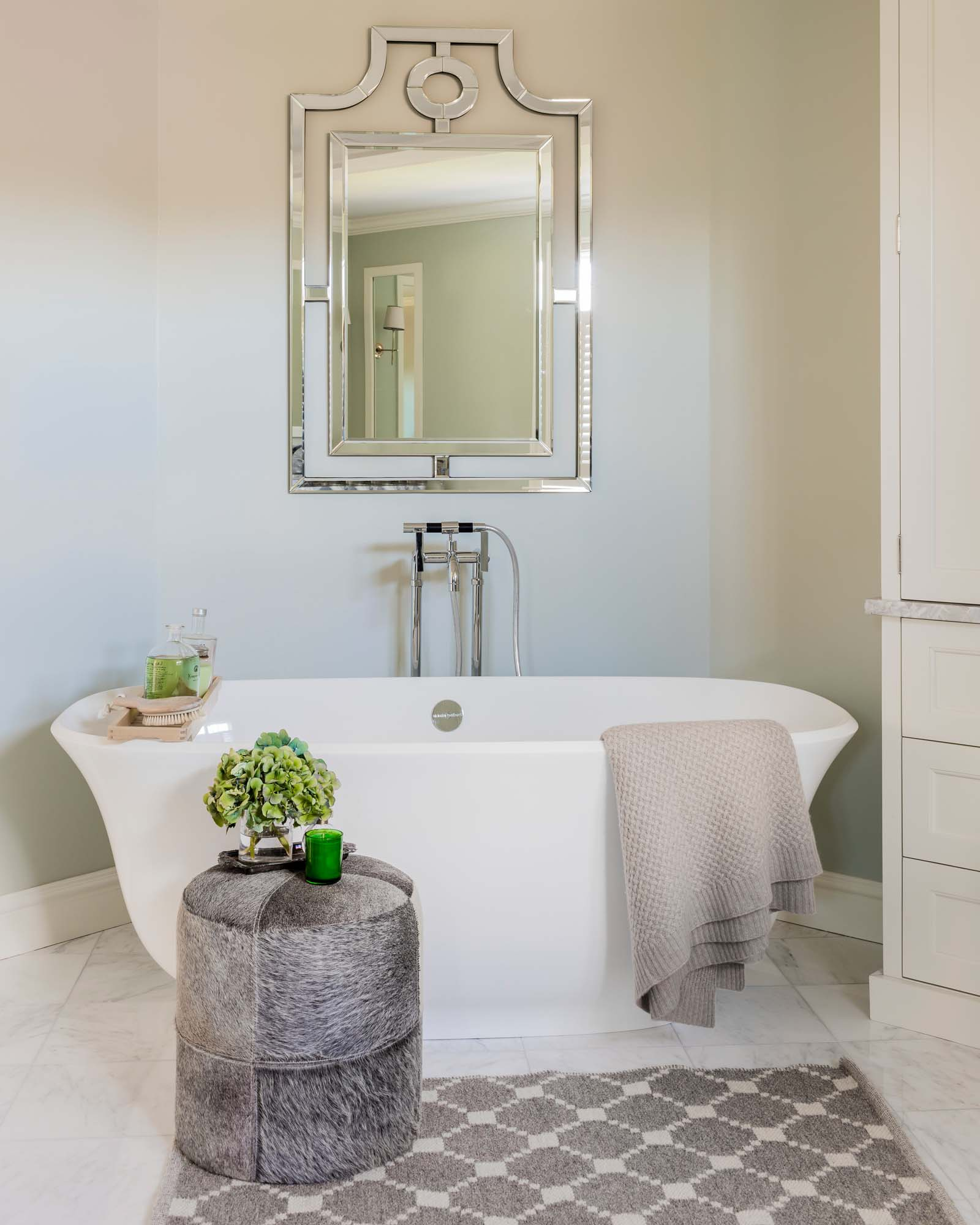 Bathroom with white bathtub and mirror, sherwin williams, pearl gray, green wall, rohl faucet, cashmere, throw, hide stool, stool, leather, arebescato, marble, arebescato marble, 12 inch