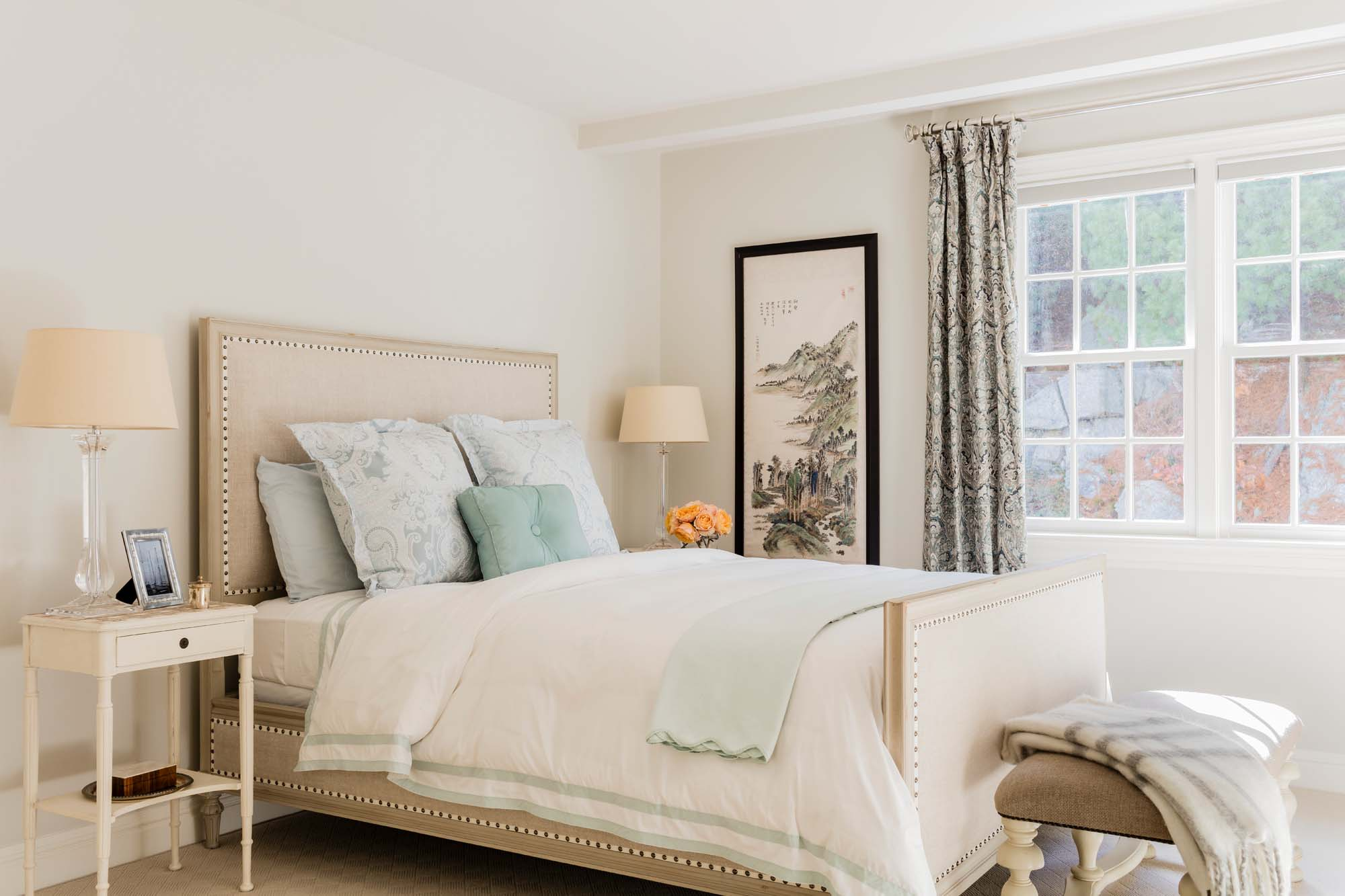 Bedroom with bed, bedside table, reading lamp, and white window frame, matouk, matouk bedding, rh, restoration hardware, art