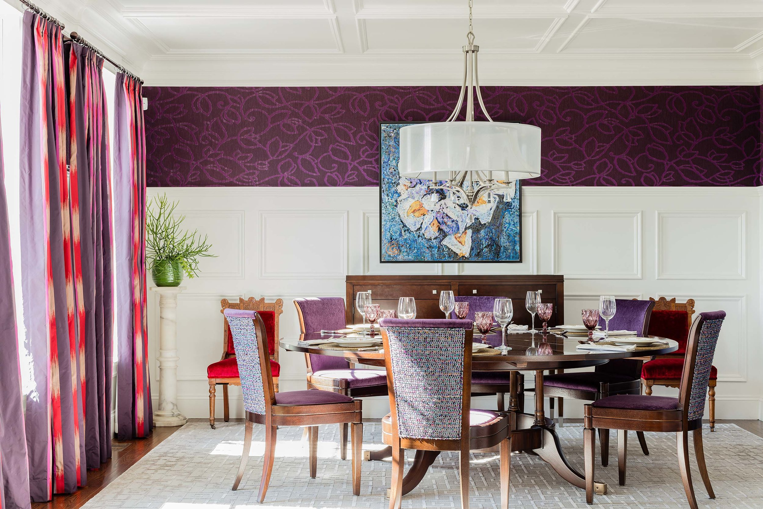 Dining room with white area rug, round wooden table, purple velvet chairs, and matching curtains, winfield thybony, wallpaper, fabric wallpaper, thomas o'brien, century furniture, chandler table
