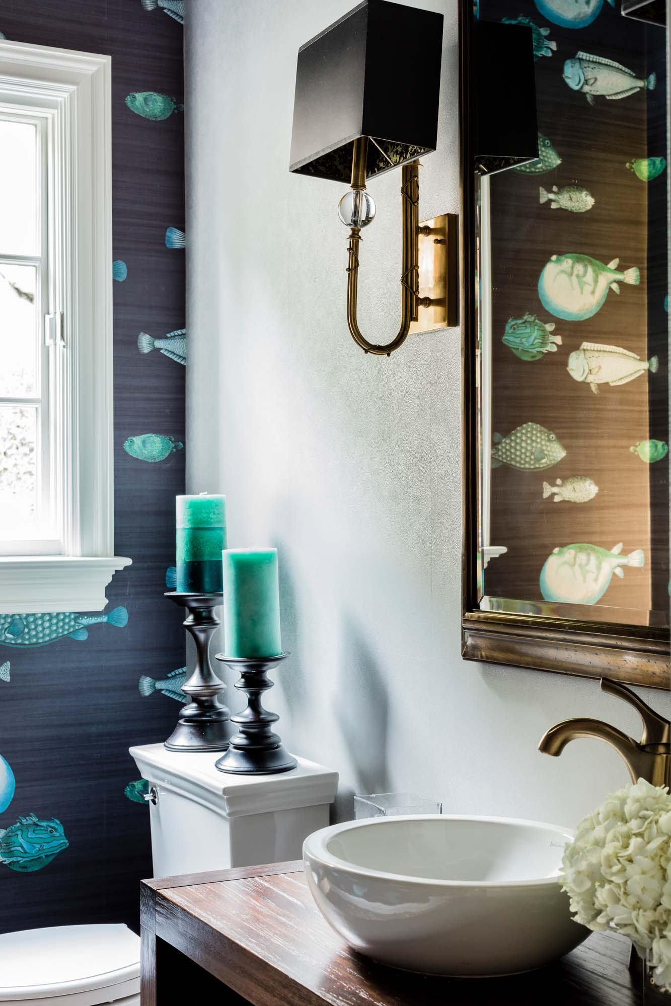 Powder room with white sink, candles and teal fish wallpaper, cole and son, fornasetti, sense tempo, acquario, fish wallpaper, visual comfort, brass light, brass sconce