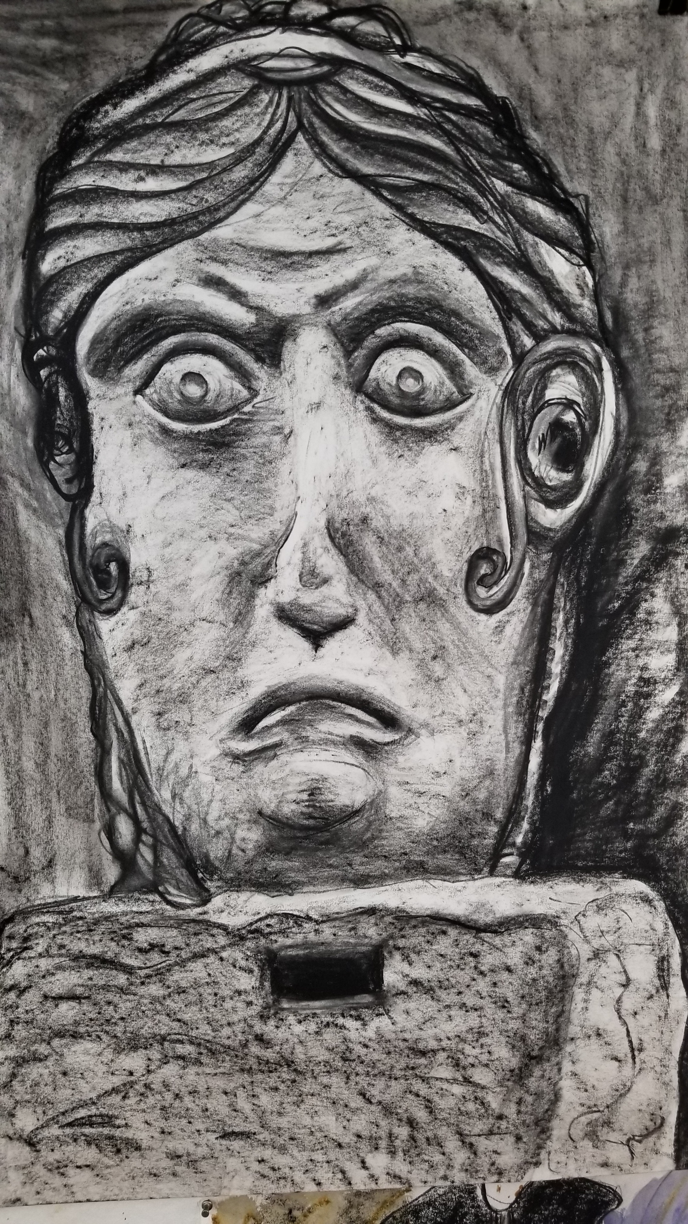 D. Wolfe, Stone Female Head