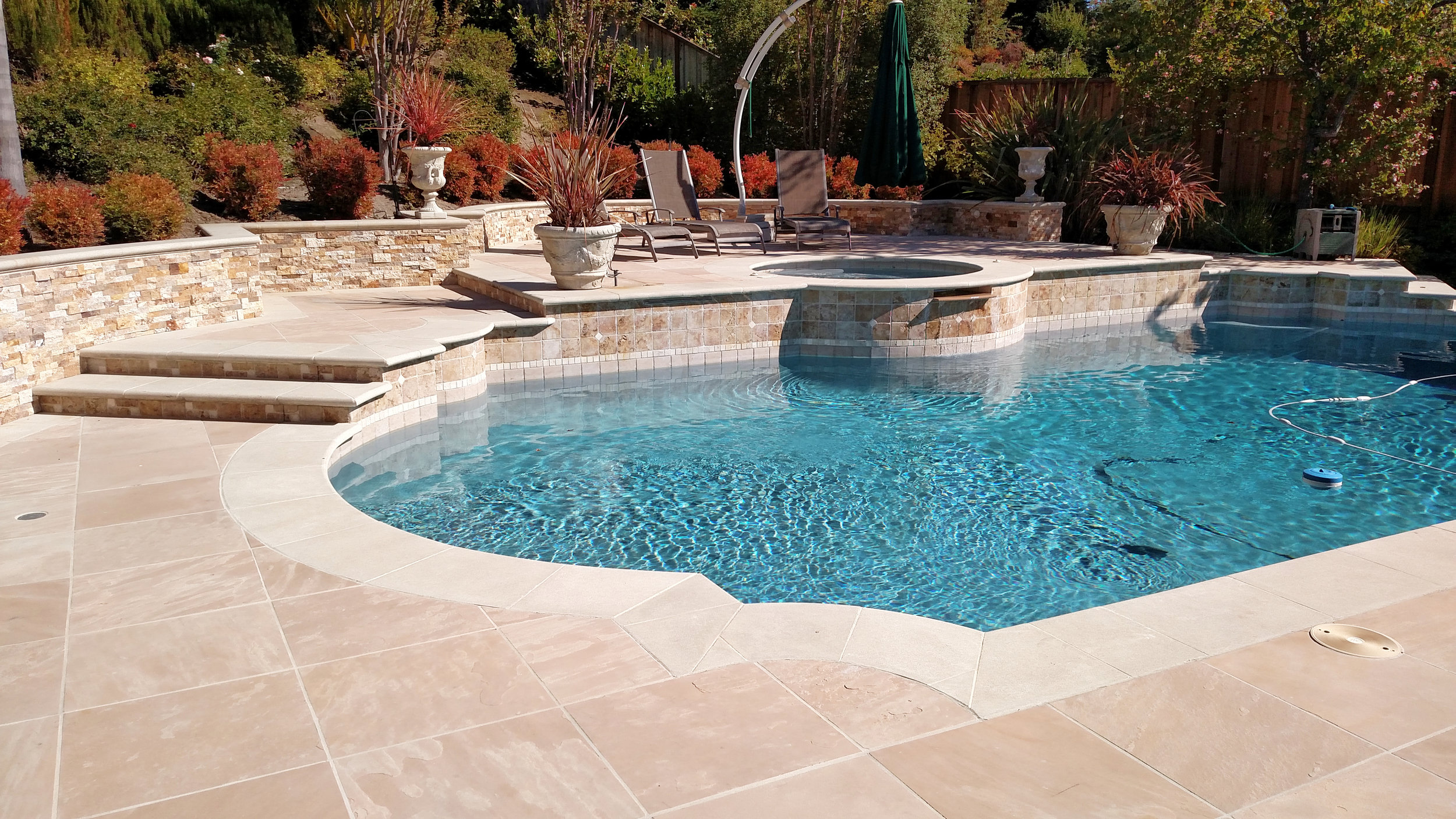 HARDSCAPE - Stamped concrete, custom rock walls, patios, walkways and more.