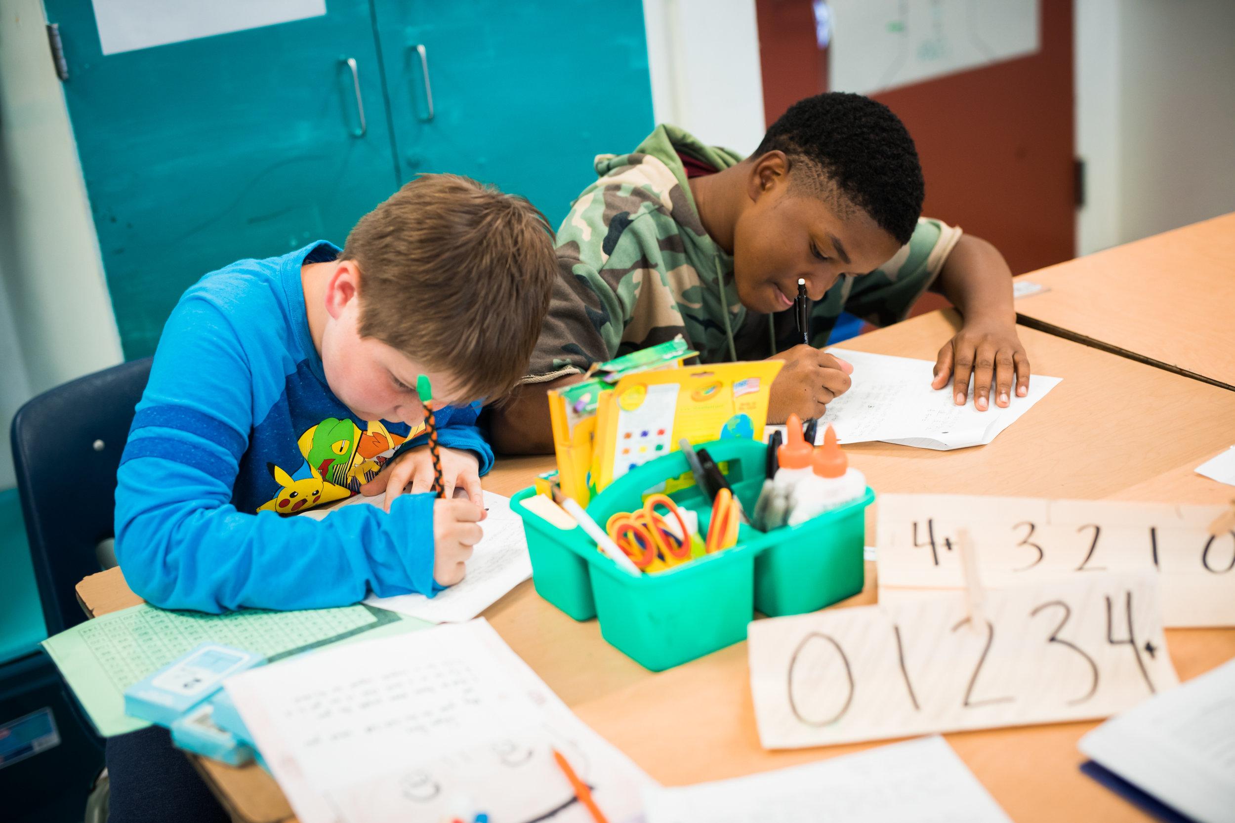 middle school students doing classwork