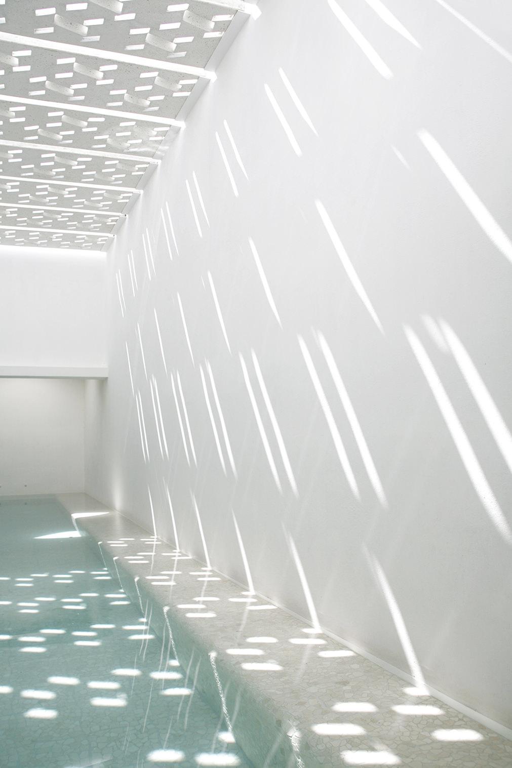 casa delpin interior pool sky shadows perforated concrete skin.jpg