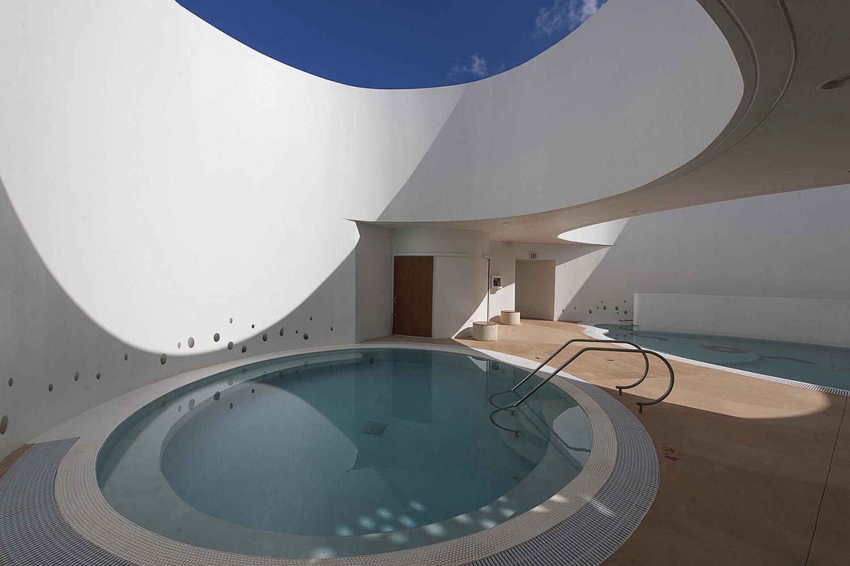 la esperanza therapeutic pools san juan interior pool natural light fuster architects.jpg