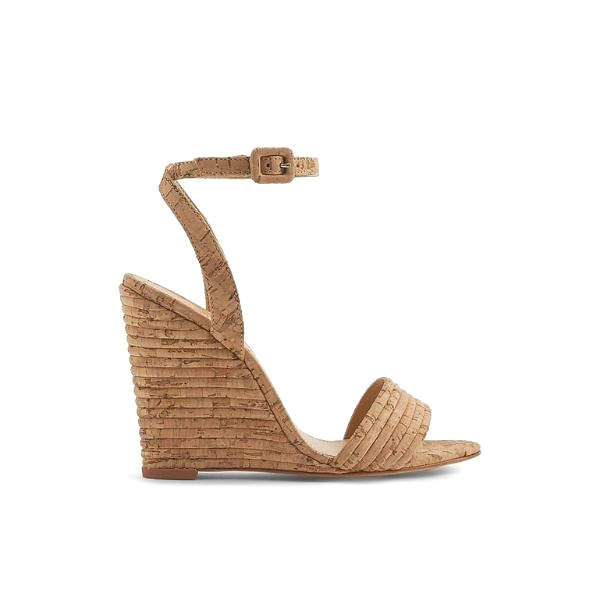 Schutz Kahritah Wedge Sandal - If I had to pick one shoe label to wear it would probably be Schutz. I love everything they do. I needed good summer sandals that I could dress up or down. I fell in love with this wedge. I love the color of it and style. I don't like all wedges some are too bulky for my taste, but I love how feminie these are! They look great with jeans, shorts and dresses. Another win with Schutz.