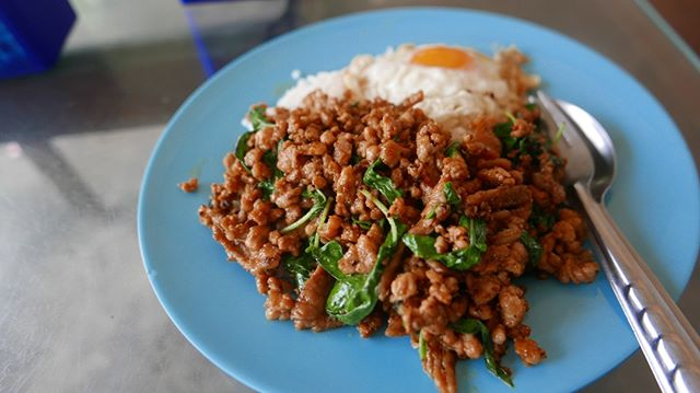 Phad Krapow is a classic Thai dish made with pork, Thai basil leaves, soy sauce, oyster sauce, sugar and chilli. So simple! What's your favourite Thai dish? Watch the video in the link below!