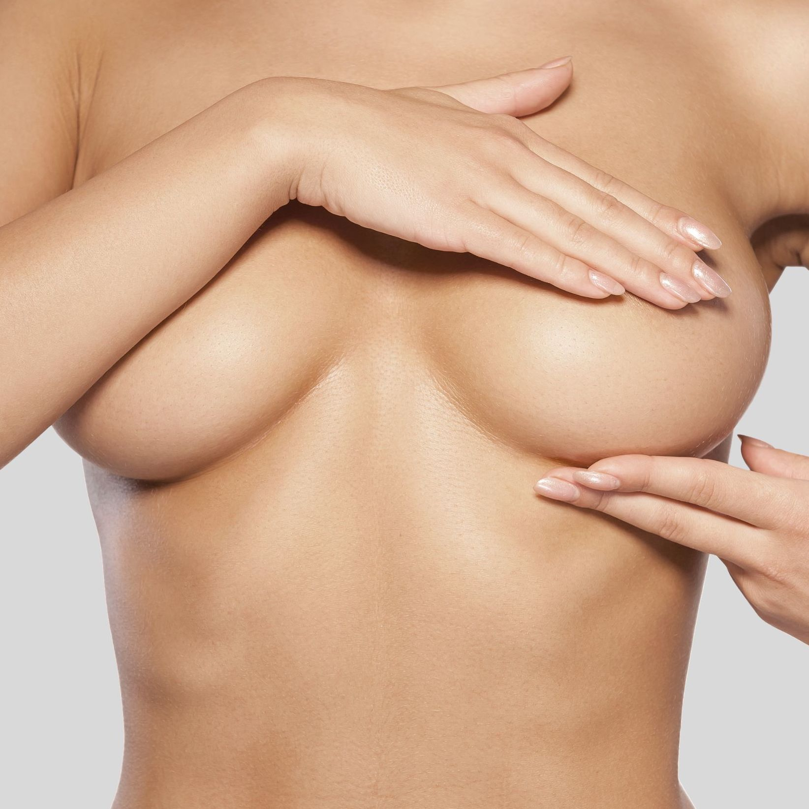 breast augmentation - Through the insertion of a silicone implant, this procedure enlarges small or sagging breasts due to pregnancy, ageing or weight-loss.